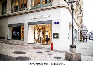 Geneva, Switzerland, March 05, 2019, Lacoste store with fashionable and luxury products, logo, sign. French clothing company, founded by tennis player Rene Lacoste. New Spring 2019 Collection