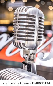 Geneva, Switzerland, March 05, 2019, Shure silver old fashioned stage microphone (Elvis microphone). Karaoke, vocal learning, music shop or radio concept. Retro style mic ready to rock