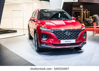 Geneva, Switzerland, March 06, 2018: metallic red Hyundai Santa Fe 4WD at 88th Geneva International Motor Show GIMS produced by South Korean multinational automotive manufacturer Hyundai Motor Company