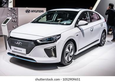 Geneva, Switzerland, March 06, 2018: white Hyundai IONIQ hybrid at 88th Geneva International Motor Show GIMS electric eco friendly car produced by South Korean automotive manufacturer Hyundai