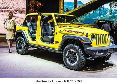 Geneva, Switzerland, March 06, 2018: metallic yellow Jeep Wrangler Rubicon at 88th Geneva International Motor Show GIMS, four-wheel drive off-road vehicle manufactured by Jeep