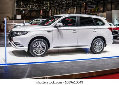 Geneva, Switzerland, March 06, 2018: metallic white new Mitsubishi Outlander PHEV EV S-AWC at 88th Geneva International Motor Show GIMS, crossover SUV produced by Japanese automaker Mitsubishi Motors