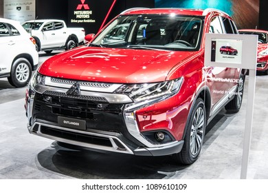 Geneva, Switzerland, March 06, 2018: metallic red Mitsubishi Outlander at 88th Geneva International Motor Show GIMS, crossover SUV produced by Japanese automaker Mitsubishi Motors