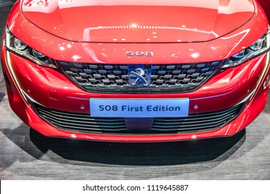 Geneva, Switzerland, March 06, 2018: metallic red new Peugeot 508 First Edition at 88th Geneva International Motor Show GIMS- car produced by Peugeot - French car manufacturer, part of Groupe PSA