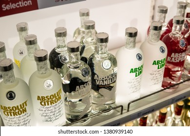 Geneva, Switzerland, March 09, 2019, Bottles of Absolut Vodka on display for sale, brand of vodka produced in Sweden Owned by Pernod Ricard brand of alcoholic spirits, Citron, Vanilia, Lime, Raspberri