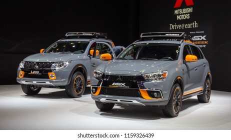 GENEVA, SWITZERLAND - MARCH 1, 2016: Mitsubishi ASX and Mitsubishi L200 cars showcased at the 86th Geneva International Motor Show.