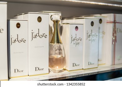 """Geneva, Switzerland, March 10, 2019: Dior J'Adore perfume on the shop display for sale, J'Adore French for """"I Love It"""", fragrance created in 1999 by Calice Becker for Dior"""