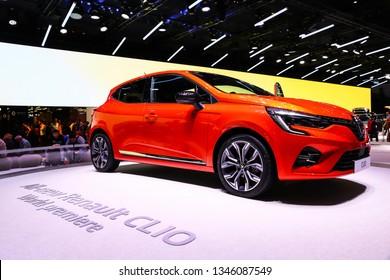 Geneva, Switzerland - March 10, 2019:  Orange motor car Renault Clio presented at the annual Geneva International Motor Show 2019.