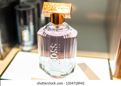 Geneva, Switzerland, March 10, 2019: Hugo Boss perfume on the store display for sale, fragrance created by Hugo Boss, German luxury fashion house