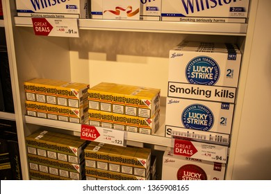 Geneva, Switzerland, March 10, 2019: pack of Lucky Strike cigarettes on shelf for sale, lusts health of man and nature, Lucky Strike is brand owned by British American Tobacco plc BAT, SMOKING KILLS