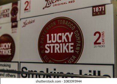 Geneva, Switzerland, March 11, 2018 packs of Lucky Strike cigarettes, lusts health of man and nature, Lucky Strike is brand owned by British American Tobacco plc BAT, Smoking kills