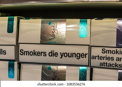 Geneva, Switzerland, March 11, 2018 pack of Vogue cigarettes, lusts health of man and nature, Vogue is brand owned by British American Tobacco plc BAT, Smoking kills