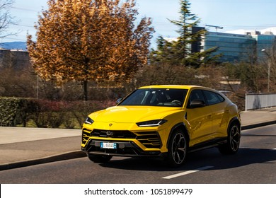 Geneva, Switzerland - March 2018: Lamborghini Urus super SUV driving in suburban Geneva. This is the first SUV by the Italian supercar brand.