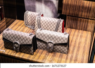Geneva, Switzerland, March 2020: Gucci fashion store, window shop, bags on display for sale, exposition of modern Gucci fashion house