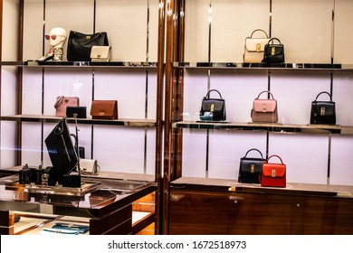 Geneva, Switzerland, March 2020: Salvatore Ferragamo fashion store, window shop, clothes, shoes, bags on display for sale, exposition of modern Salvatore Ferragamo fashion house