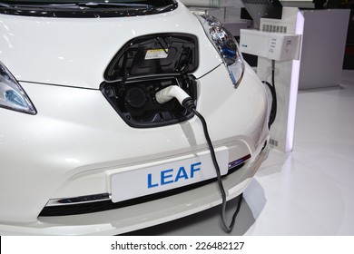 GENEVA, SWITZERLAND - MARCH 4, 2014: Nissan Leaf and charging station on display during the Geneva Motor Show.