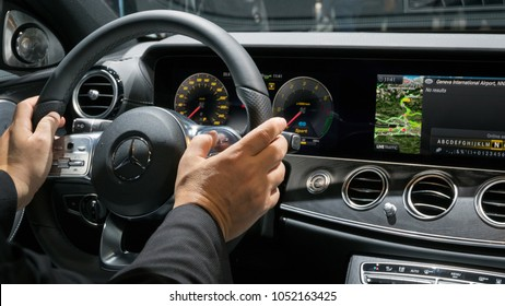 GENEVA, SWITZERLAND - MARCH 7, 2018: Interior dashboard view of the new Mercedes Benz E300 Diesel Hybrid car at the 88th Geneva International Motor Show.