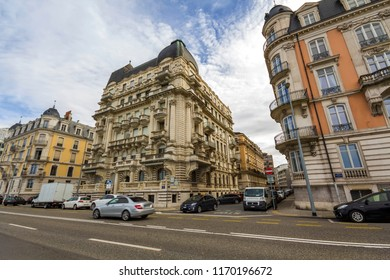 Geneva, Switzerland - March 9, 2018: New modern cars moving fast on street of historical center of Geneva city with view of old architechture buildings. Travelling in Europe and transportation concept