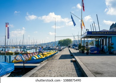Geneva, Switzerland - May 11, 2018 : a woman cleans the pedal boats at the boat rental booth.