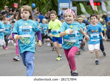 GENEVA, SWITZERLAND - MAY 2, 2015: Unidentified young athletes run in the childrens race as part of the Harmony Geneva marathon for UNICEF.