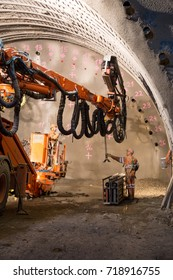 Geneva, Switzerland - May 22, 2014: Two workers preparing the machine for the construction of piperoof grouting for a tunnel