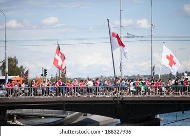 GENEVA, SWITZERLAND - MAY 5: A group of participants run through the Mont-Blanc bridge at the Geneva marathon 2012.