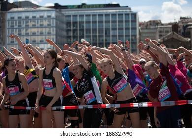 GENEVA, SWITZERLAND - MAY 5:  A group of unidentified girls warm up before the start of the Geneva marathon 2012.