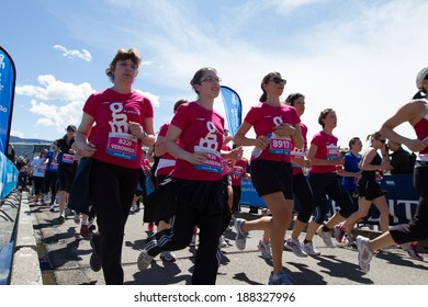 GENEVA, SWITZERLAND - MAY 5: A group of unidentified woman run at the Geneva marathon 2012.