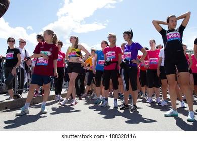 GENEVA, SWITZERLAND - MAY 5: A group of unidentified woman wait for the beginning of the Geneva marathon 2012.