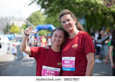 GENEVA, SWITZERLAND - MAY 5: Two participants of the Geneva marathon 2012 pose together for a portrait.