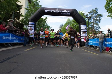 GENEVA, SWITZERLAND - MAY 6 : The speaker of the race runs with the participants at the beginning of the Geneva marathon 2012 to motivate them.