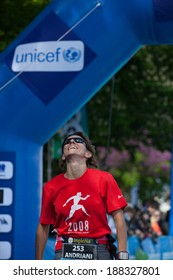 GENEVA, SWITZERLAND - MAY 6 : An unidentified participant of the Geneva marathon  2012 recovers after crossing the finish line