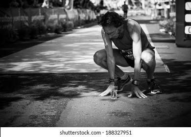 GENEVA, SWITZERLAND - MAY 6 : An unidentified participant of the Geneva marathon  2012 recovers after crossing the finish line under four hours.