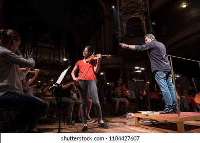 Geneva, Switzerland, May 8 2018: The UN Orchestra conducted by Antoine Marguier in rehearsal at the Victoria Hall with Soloist Violinist Liya Petrova  on the occasion of Europe Day 2018.