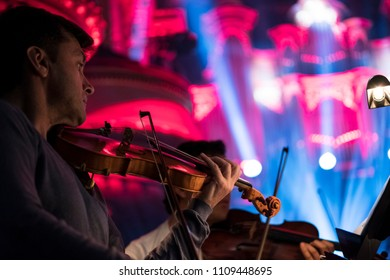 Geneva, Switzerland - May 8 2018: A member of the UN Orchestra, conducted by Antoine Marguier, in rehearsal at the Victoria Hall.