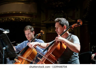 Geneva, Switzerland - May 8 2018: Members of the UN Orchestra, conducted by Antoine Marguier, in rehearsal at the Victoria Hall.