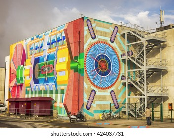 GENEVA, SWITZERLAND - NOV 24, 2014: The exterior of the Atlas lab building at CERN in Geneva shows a picture of the physics of the large hadron collider inside.
