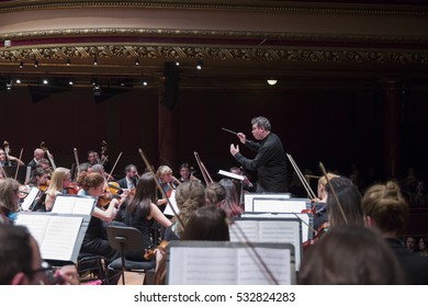 GENEVA, SWITZERLAND - NOVEMBER 26, 2016: Antoine Marguier conducts the United Nations Orchestra at a concert of cinema music at the Victoria Hall.