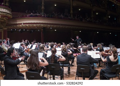 GENEVA, SWITZERLAND - NOVEMBER 26, 2016: Antoine Marguier conducts the United Nations Orchestra at a concert of cinema music at the Victoria Hall including from Titanic, James Bond and Harry Potter.