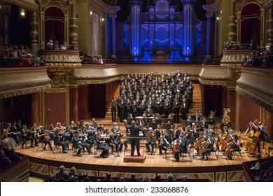 GENEVA, SWITZERLAND - NOVEMBER 8, 2014: The UN Orchestra conducted by Antoine Marguier performs at the Victoria Hall with the choir of the Polytechnic University of Madrid.