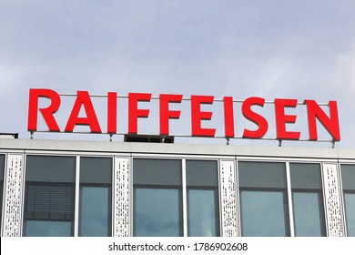Geneva, Switzerland - October 1, 2017: Raiffeisen logo on a building. Raiffeisen is a Swiss cooperative bank. After UBS and Credit Suisse, it is the third largest bank in Switzerland