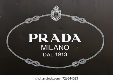 GENEVA, SWITZERLAND – OCTOBER 1, 2017: A Prada poster. Prada was founded in 1913 It's products are made in thirteen company-owned sites, The Group's distribution network extends across 70 countries.
