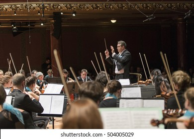 GENEVA, SWITZERLAND, OCTOBER 2, 2016: Antoine Marguier conducts the UN Orchestra in the Victoria Hall at a concert in honor of outgoing United Nations Secretary General Ban Ki-moon.