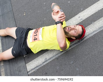 GENEVA, SWITZERLAND – OCTOBER 29, 2017: An exhausted unidentified athlete checks his time at the end of the inaugural edition of the Geneva 20km race.