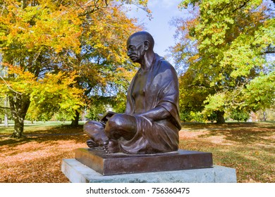 "GENEVA, SWITZERLAND – October 30, 2017 : bust of Mahatma Gandhi offered by the Republic of India to the City of Geneva. The inscription invites to meditation: ""My life is my message""."
