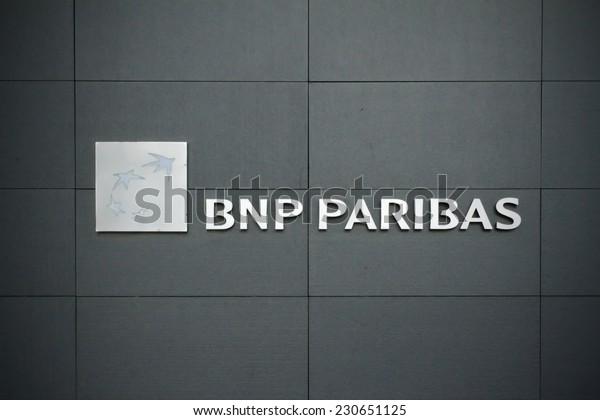 GENEVA, SWITZERLAND, SEPT 7 : BNP logo on black bank wall on september 7, 2014.