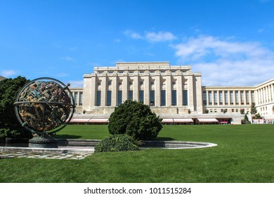 "GENEVA, SWITZERLAND - SEPTEMBER 15, 2012: The sculpture ""Armillary sphere"" (celestial sphere). It is a gift of the Woodrow Wilson Foundation fellow. In the background the Palace of Nations of the UN."