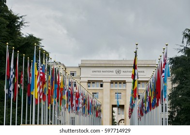 GENEVA, SWITZERLAND - SEPTEMBER 16, 2016:United Nation building entrance with the flags of all nations world wide on both sides in Geneva, Switzerland. UN was established in Geneva in 1947
