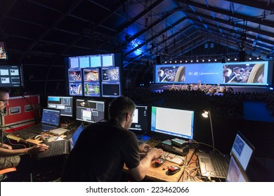 GENEVA, SWITZERLAND - SEPTEMBER 19, 2014: Technicians work at a concert by the UN Orchestra conducted by Antoine Marguier at the 60th anniversary of CERN the European Organization for Nuclear Research