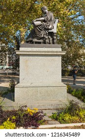 Geneva, Switzerland - September 24, 2016: a statue of Jean-Jacques Rousseau in the city of Geneva. Jean-Jacques Rousseau was a Genevan philosopher, writer and composer.